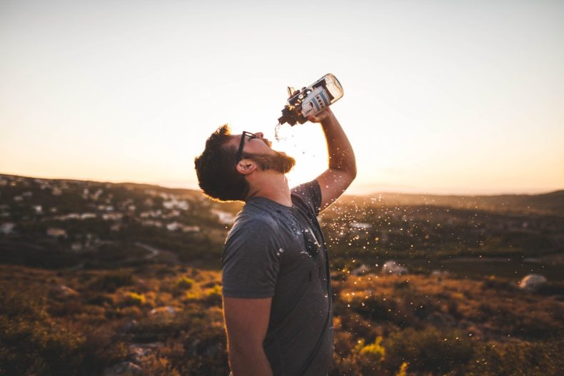 Drink water while hot weather hiking